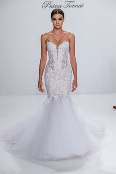 This is a beautiful Pnina tornai dress that I wore once at my January 2015 wedding. Purchased and altered with the highest quality at Kleinfelds in NYC. The lace is exquisite and dress is made of the finest fabrics. This dress is perfect balance of elegant and sexy with Pnina's corset style.