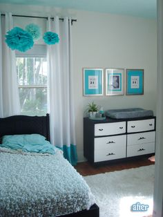 cool bedroom. Love the prints in background I think they are the kids time of birth- if not wouldn't that make the cutes/coolest art