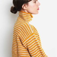 Pure Wool Women´s jumper crafted in Spain. A mix of undyed and ochre Spanish…