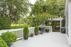 Space to barbecue and enjoy a glass of wine in the evening on your deck. You will love the convenience of the drip irrigation system for all of the potted plants. #forsale