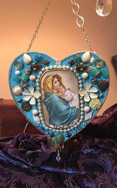 A personal favorite from my Etsy shop https://www.etsy.com/listing/562345342/holy-mother-and-child-hanging-heart