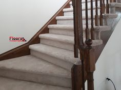 Plush light carpet on stairs, supplied and installed by Floors in Motion.
