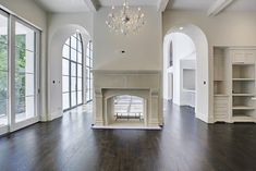59 Tiel Way Houston, TX Photo Double sided cast stone Isokern fireplace separates the living and breakfast areas Two Sided Fireplace, Double Sided Fireplace, Shiplap Fireplace, Farmhouse Fireplace, Fireplace Design, Double Sided Stove, Cast Stone Fireplace, Fireplace Candles, Cabin Fireplace
