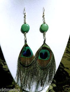 ZoomStart of LayerEnd of LayerSell one like this Genuine Green Turquoise and Peacock Feather Dangle Earrings  $16.99