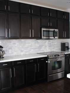 Dark Birch kitchen cabinets with Shining White Quartz counters and White Marble backsplash: Dark cabinets with dark floors Birch Kitchen Cabinets, Dark Brown Kitchen Cabinets, Backsplash With Dark Cabinets, Brown Kitchens, Home Kitchens, Backsplash Ideas, Backsplash Design, White Cabinets, Dark Counters