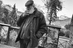 Athens Europe black capital city old people smoking street photography white