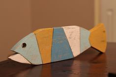 A personal favorite from my Etsy shop https://www.etsy.com/listing/226496292/wooden-fish-wall-art-nautical-striped