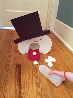 Fine Motor Fun! Snowman Snowball Game. Promotes isolated finger movements, Hand strengthening, visual motor coordination skills. Visit pinterest.com/arktherapeutic for more #finemotor ideas