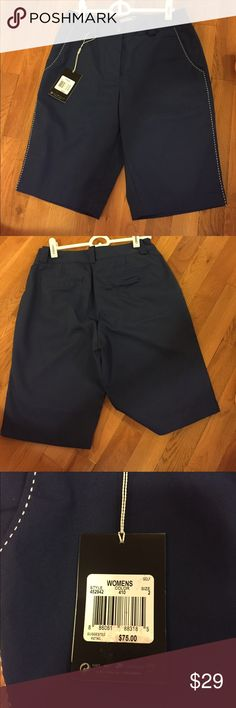NWT Nike Performance Dri-Fit Golf shorts size 2 These golf shorts have never been worn and still have the tag on them. They are a size two. They are navy blue with white stitching down the side. They go to right above the knee. They are made with dri-fit material so you can stay cool during your game of golf. Feel free to make me an offer! Nike Shorts Bermudas