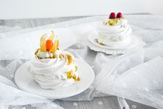 Pavlovas with basil whipped cream, passion fruit, peruvian gooseberries and raspberries