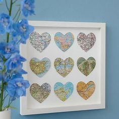 Awesome idea: Cut out heart shapes from maps showing where you met, where you've lived, where you've traveled