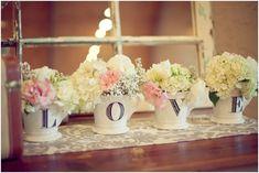 """LOVE"" on coffee mugs with flowers"
