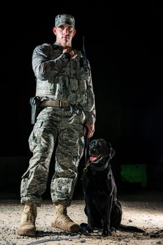 U.S Air Force Staff Sgt. Jesse Galvan, 386th Expeditionary Security Forces Squadron military working dog handler, poses with his dog, Ritz, July 16, 2014 at an undisclosed location in Southwest Asia. Galvan has been partnered with Ritz for two and a half years and deployed twice with her. The Dallas-Ft. Worth native deployed here from Tinker Air Force Base, Oklahoma in support of Operation Enduring Freedom. (U.S. Air Force photo by Staff Sgt. Jeremy Bowcock)