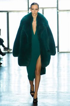 Cushinie Et Ochs has a fur coat that is the main focus of this look. With the…
