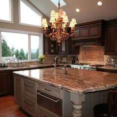 Crema Bordeaux Granite - looks beautiful with grey.  I want to do white cabinetry, this granite, and grey walls and grey island.