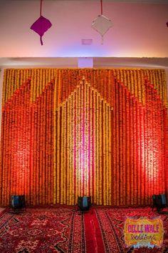 Yellow And Orange Genda Phool Backdrops - Garjana and Rajat - Happy Weddings in Pushkar - Happy Shappy Wedding Hall Decorations, Marriage Decoration, Engagement Decorations, Backdrop Decorations, Festival Decorations, Diwali Decorations, Decor Wedding, Wedding Mandap, Wedding Garlands