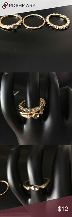 Gold forever21 Ring set size 7 Gold forever 21 ring set comes with 3 rings.the rings are gold. Size 7 in ring size. Two of the rings have gems in them. Smoke free home.Never wore. Forever 21 ring set . Forever 21 Jewelry Rings
