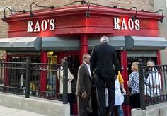Toughest reservation in the US to get:   RAO's and oh the stories. . . patrons standing outside Rao's in New York City (© James Keivom/NY Daily News Archive/Getty Images)