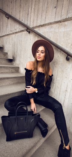 Bohemian style + all black outfit + Kenza Zouiten + off the shoulder top +  leather leggings.