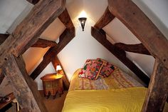 350 year old beams frame what could be quite the awesome sleep experience (in the quartier latin, paris)