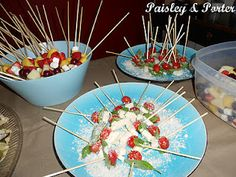 food for Kayla's nautical baby shower. Caprese and fruit salad kebabs.