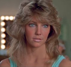 Image may contain: 1 person, closeup Beautiful Blue Eyes, Most Beautiful Faces, Beautiful Celebrities, Beautiful Women, Heather Locklear, Blonde Actresses, 80s Hair, Farrah Fawcett, Feathered Hairstyles
