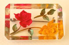 "Reversed carved clear lucite brooch 1950s vintage yellow and red rose green leaves.  Measures 2''x 1.5"" rectangle with bevelled edges and 1/4"" thick. Wonderful reflection.  Fine vintage condition, some light scratches from normal wear."