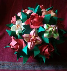 Spring roses kusudama  Spring kusudama   Folded  by  me ,  Majomajo   :)  / Base: Immortelle by Ekaterina Lukasheva, flowers Fukuyama Rose and Four Petal flower Vicente Dolz