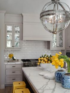 Gorgeous yellow & gray kitchen design with soft gray kitchen cabinets, beveled white subway tiles backsplash, Calacatta Oro marble countertops, bright yellow Tolix Counter Stools and Restoration Hardware Victorian Hotel Pendant Polished Nickel. Kitchen And Bath, New Kitchen, Kitchen Dining, Kitchen Decor, Kitchen Yellow, Kitchen Grey, Kitchen Ideas, Ranch Kitchen, Yellow Kitchens