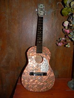 Guitar with penny's glued on it. Created by Jodi @ https://www.facebook.com/TheFinishForYou