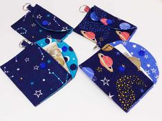 These keyring purses have star and planet themed fabric. They are lined with complementary star and moon fabric too.  Fastened with a snap fastener and they are big enough to fit credit cards.