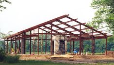 Interior Steel Structure of the Kodiak Steel Homes model with a fire-place.  Kodiak Steel Homes red-iron structural framing contains up to 60% recycled steel. #greenbuilding #homes #construction #architecture