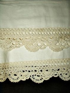 Pillow cases with crochet edging.