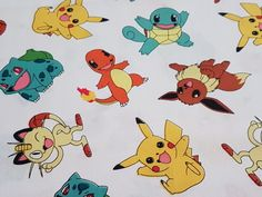 Pokemon Fabric  Be the apple of your child's eye with this Pokemon fabric it's fantastic quality you won't be disappointed.  Features many of the characters kids love, including Pikachu.  100% Cotton  112cm wide.  1 Unit = 1 Fat Quarter 56 cm x 50 cm  4 Units = 1 Meter