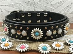 This leather dog collar is just pretty, pretty, pretty! Four daisy flower conchos embellish this custom collar. Decorative details are studding with mini silver flat top studs, chose of gemocite stones, and your choice for the flower head in Pink, Yellow or Turquoise surrounded by long white ray petals