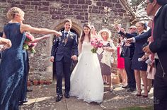 Confetti outside church from wedding at Sopley Mill. Photography by one thousand words wedding photographers