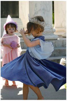 Girl spinning in blue Appleblossom dress