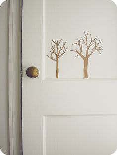 small trees painted on doors