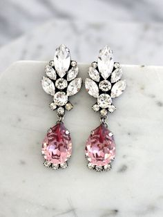 Blush Chandelier Earrings, Blush Pink Long Earrings, Bridal Blush Dangle Drop Earrings, Antique Pink Chandelier Earrings, Vintage Earrings Add a sophisticated stylish glow to any outfit with these beautiful light weight Swarovski crystal chandeliers.  Details : ♥ U.S packages shipped via USPS® insured+USPS® tracking number ♥ 1 year guarantee ♥ Materials- 14k Gold or Silver Plated over brass CRYSTALLIZED™ Swarovski Element ♥ Posts on top ♥ Size approx (54mm h x 18.5mm w), (2 h x 0.7 w) ♥…