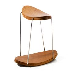 Geometry never looked so good with this tetrahedron inspired rocking stool. Supported by stainless steel legs, the teak wood Handmade by Yaacov Kaufman.
