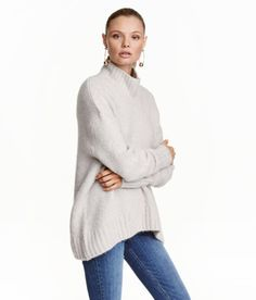 Check this out! Wide-cut knit sweater in a soft wool blend with a ribbed turtleneck. Dropped shoulders, long sleeves, and ribbing at cuffs and hem. Longer at back. - Visit hm.com to see more.