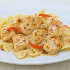 Serve Roasted Garlic & Bell Pepper-seasoned chicken over pasta so you can enjoy every drop of the rich creamy sauce.