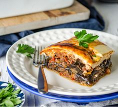 Chew Town's healthy Greek moussaka uses baked eggplant rounds, replaces half the lamb mince with meaty-tasting mushrooms, and has a lighter, cheesy topping. Baked Eggplant, Eggplant Recipes, Meat Recipes, Cooking Recipes, Healthy Recipes, Lamb Mince Recipes, Lasagna Recipes, Healthy Dishes, Healthy Foods