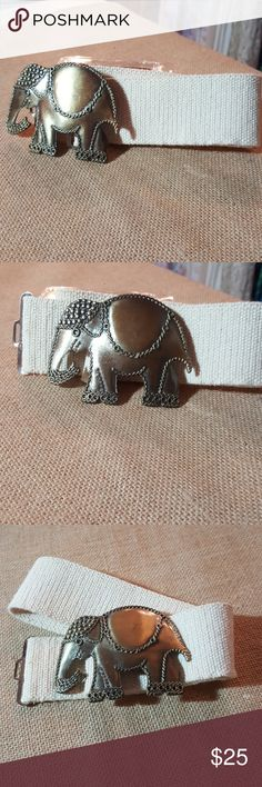 Elephant stretch belt This is a great looking belt. It is a heavy brass elephant that hooks into a hoop. Looks amazing with any outfit. Accessories Belts