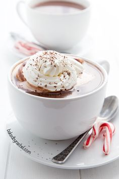 Homemade peppermint hot chocolate with peppermint whipped cream. Recipe from @bakedbyrachel The perfect drink for winter!