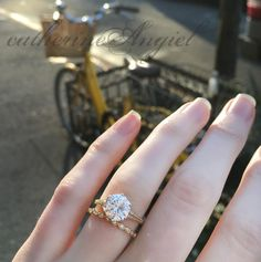 Yellow gold, vintage inspired engagement ring set with a 2.00 carat round cut diamond, paired with a diamond baby bliss wedding band. Handcrafted by he artist, Catherine Angiel