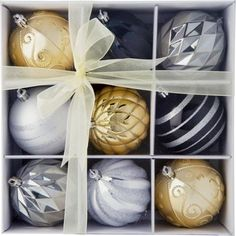 Pack of 9 Silver, Black & Gold Baubles at Homebase -- Be inspired and make your house a home. Buy now.