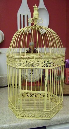 Large birdcage that I have painted yellow and have distressed. YOu can see the green under the chippy paint. Has a wood final on top with hoop for hanging. Shabby Chic Yellow, Birdcages, Shades Of Yellow, Cottage Homes, Mellow Yellow, Terrariums, Birdhouses, Sunshine, Charlotte
