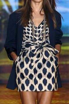 I love the jacket with this dress. Very clever and modern, with just the right amount of feminine flare.