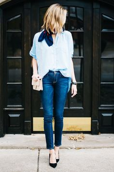 Achieve French girl chic with a chambray shirt, cigarette jeans, black pointed pumps, and a silk neck scarf.